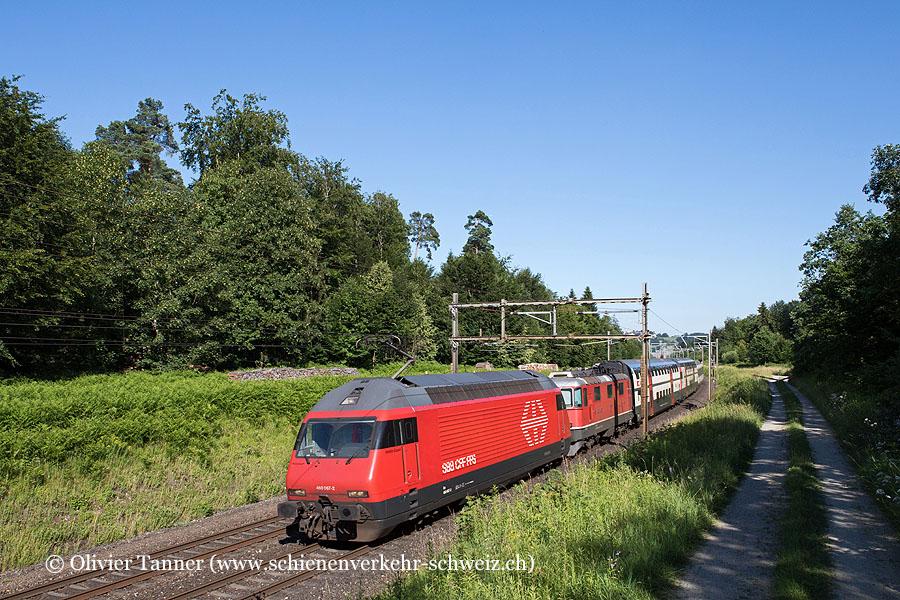 Re 460 067 mit Re 4/4'' 11130 und Überfuhrwagen Olten – Bern – Genève