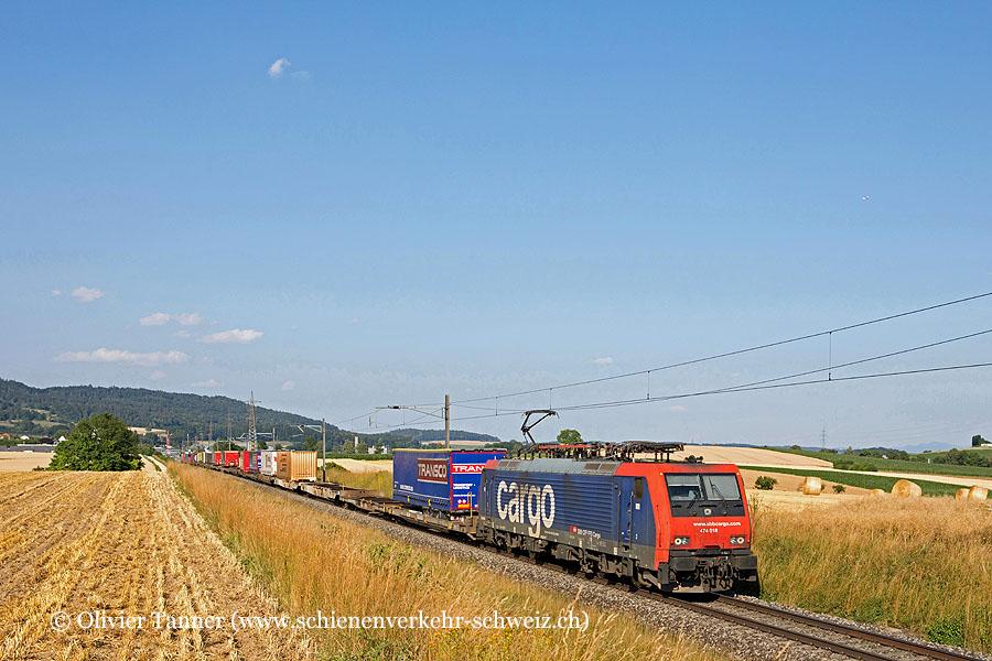Re 474 018 mit einem Transitgüterzug